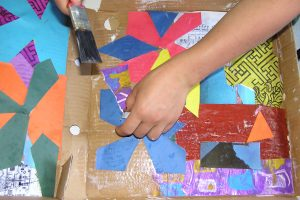 Gluing more strips of paper